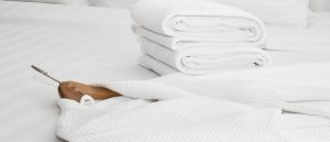 white robe and towels on a bed
